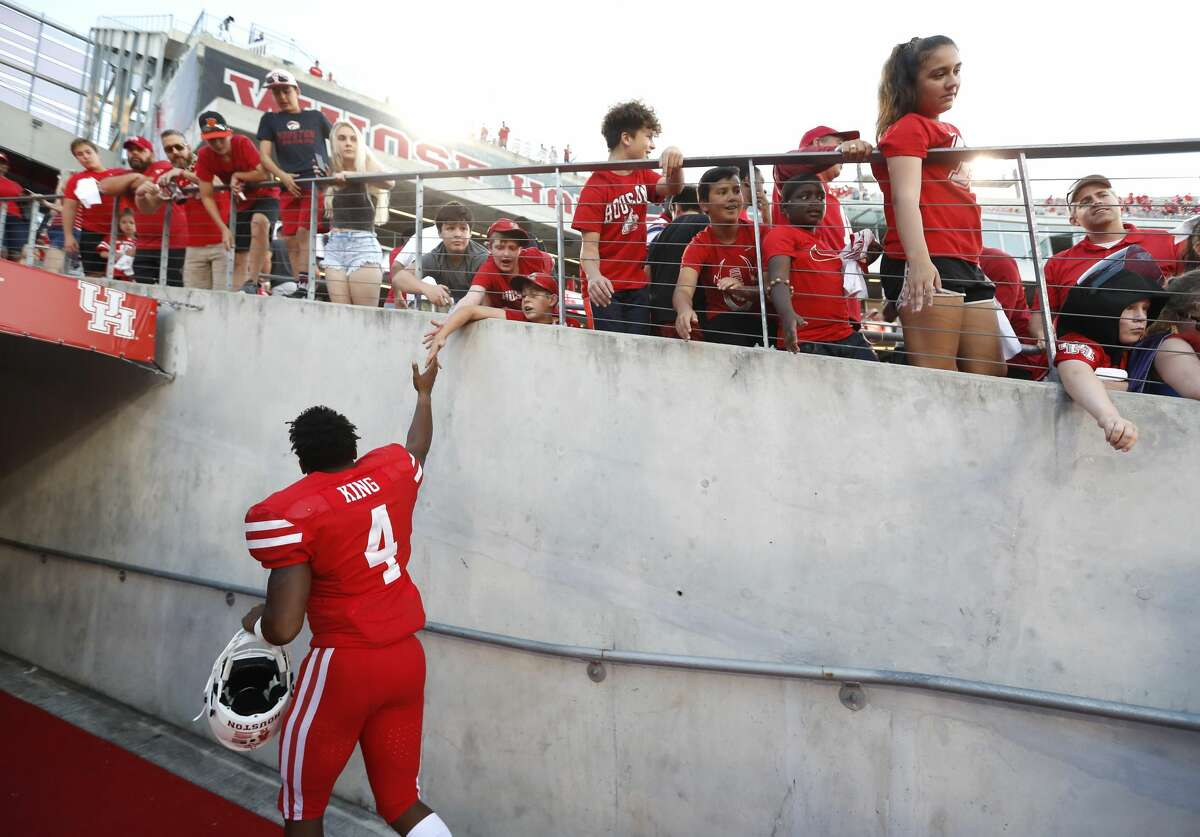 Houston Cougars quarterback D'Eriq King (4) walks up the tunnel as fans cheered him after the Cougars beat South Florida Bulls 57-36 during a college football game at TDECU Stadium, Saturday, Oct. 27, 2018, in Houston.