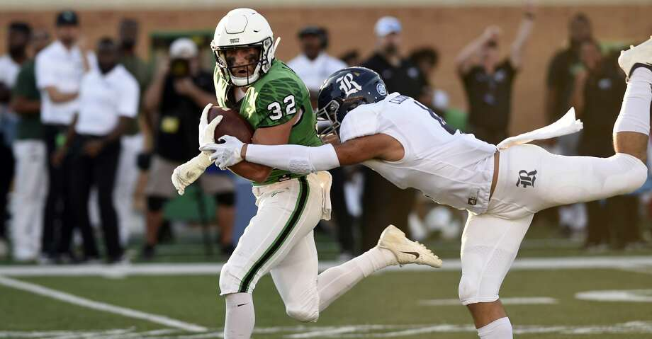 North Texas Mean Green wide receiver Michael Lawrence (32) catches the ball during the game against Rice on Saturday, Oct. 27 at Apogee Stadium in Denton, Texas. Photo: Jake King/DRC