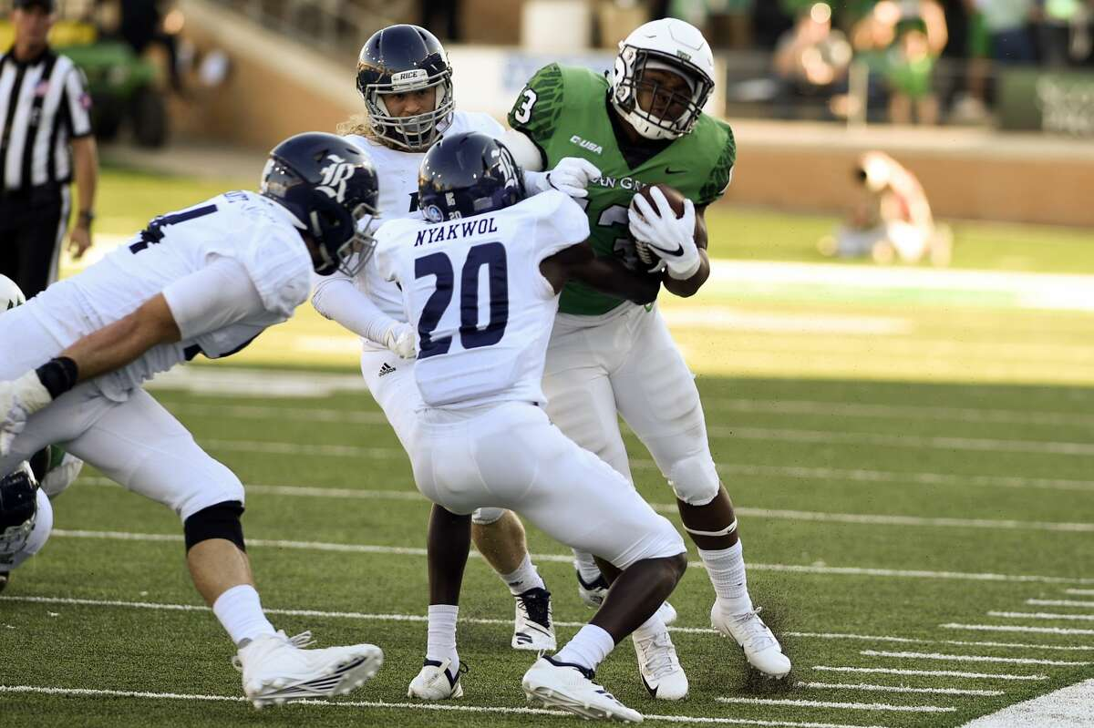 Rice defensive back George Nyakwol 92) disrupts North Texas running back DeAndre Torrey (13) during the game on Saturday, Oct. 27 at Apogee Stadium in Denton, Texas.