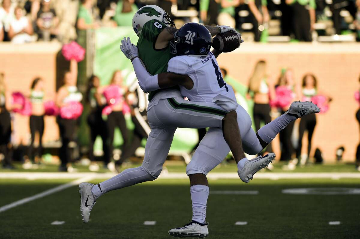 North Texas Mean Green wide receiver Rico Bussey Jr. (8) battles with Rice defensive back Prudy Calderon (4) for the ball during the game on Saturday, Oct. 27 at Apogee Stadium in Denton, Texas.