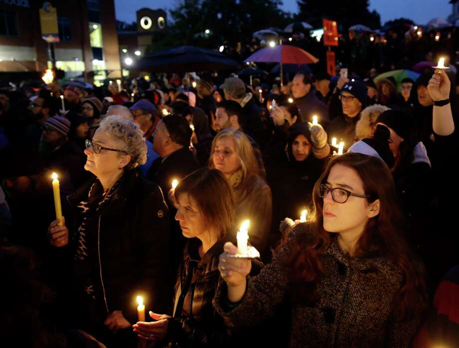 People hold candles as they gather for a vigil in the aftermath of a deadly shooting at the Tree of Life Congregation, in the Squirrel Hill neighborhood of Pittsburgh, Saturday, Oct. 27, 2018. (AP Photo/Matt Rourke) Photo: Matt Rourke / Copyright 2018 The Associated Press. All rights reserved.