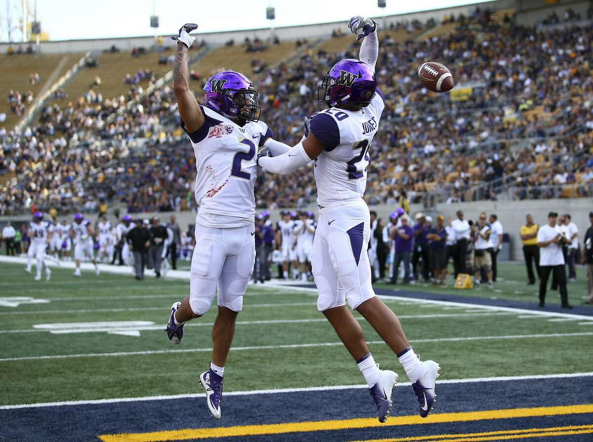 Washington's Ty Jones, right, celebrates with Aaron Fuller (2) after scoring a touchdown against California in the first half of an NCAA college football game Saturday, Oct. 27, 2018, in Berkeley, Calif. (AP Photo/Ben Margot)