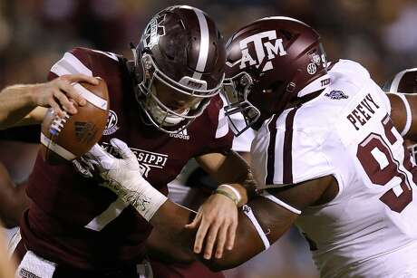 STARKVILLE, MS - OCTOBER 27: Nick Fitzgerald #7 of the Mississippi State Bulldogs is sacked by Jayden Peevy #92 of the Texas A&M Aggies during the second half at Davis Wade Stadium on October 27, 2018 in Starkville, Mississippi.  (Photo by Jonathan Bachman/Getty Images)