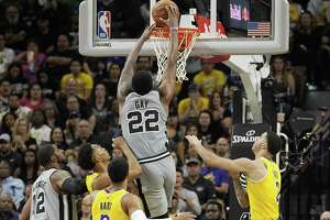 Rudy Gay of the San Antonio Spurs dunks over Lonzo Ball, right, Josh Hart and Johnathan Williams of the Los Angeles Lakers as Gay's teammate, LaMarcus Aldridge (12) watches during late second-half NBA action at the AT&T Center on Saturday, Oct. 27, 2018. The Spurs won, 110-106.