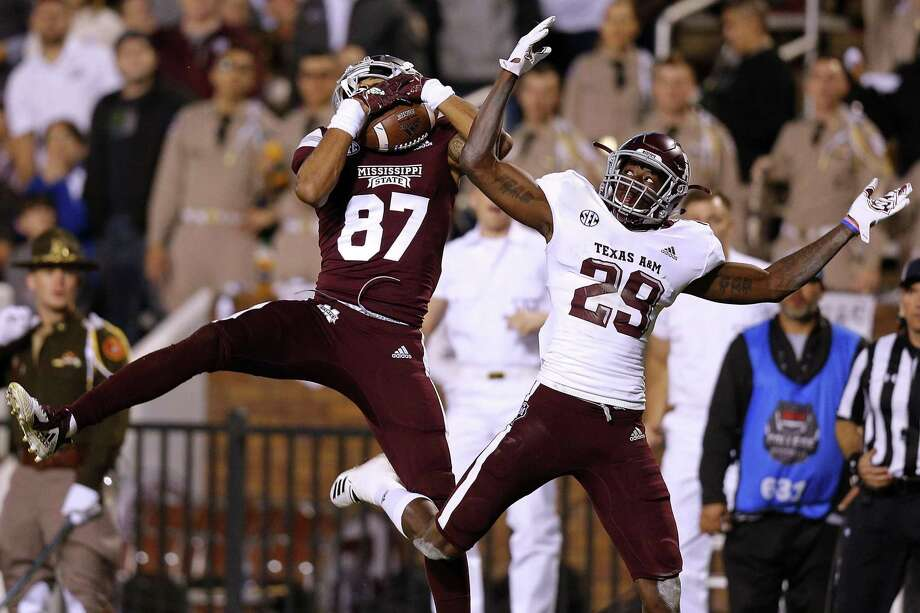 PHOTOS: College football money rankings  Mississippi State's Osirus Mitchell, left, snares a 38-yard touchdown pass in front of Texas A&M's Debione Renfro during the third quarter Saturday night at Davis Wade Stadium. >>>See the richest college football programs in the country ...  Photo: Jonathan Bachman, Stringer / Getty Images / 2018 Getty Images