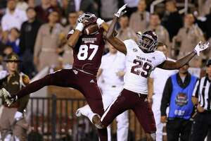 Mississippi State's Osirus Mitchell, left, snares a 38-yard touchdown pass in front of Texas A&M's Debione Renfro during the third quarter Saturday night at Davis Wade Stadium.