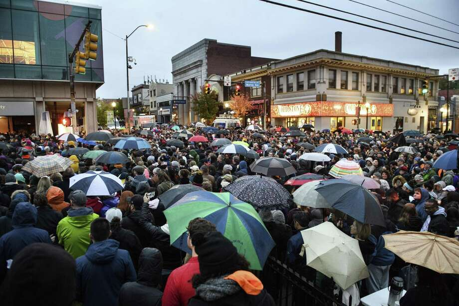 People gather for a vigil on Murray and Forbes Avenues, blocks from where an active shooter shot multiple people at Tree of Life Congregation synagogue on Saturday, Oct. 27, 2018, in the Squirrel Hill section of Pittsburgh. (Stephanie Strasburg/Pittsburgh Post-Gazette via AP) Photo: Stephanie Strasburg, MBI / Associated Press / Pittsburgh Post-Gazette
