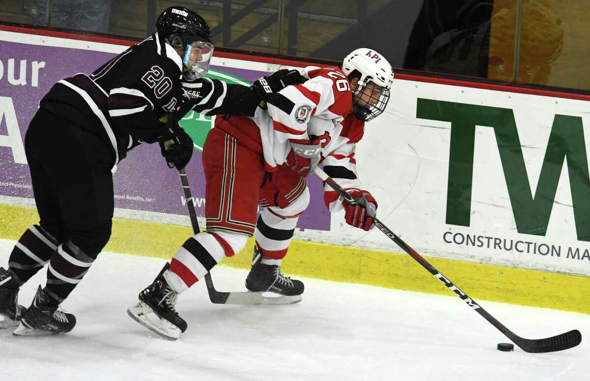 RPI forward Jake Marrello protects the puck from Union defenseman Greg Campbell during a game on Saturday, Oct. 27, 2018 at Union College in Schenectady, N.Y. (Jenn March, Special to the Times Union)