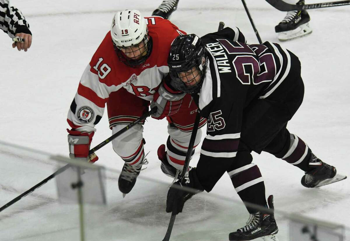 RPI forward Ture Linden and Union forward Ryan Walker pursue the puck during a game on Saturday, Oct. 27, 2018 at Union College in Schenectady, N.Y. (Jenn March, Special to the Times Union)