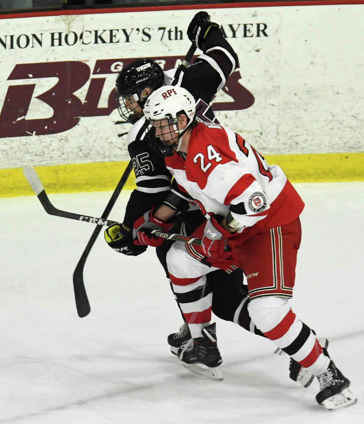 RPI defenseman Will Reilly and Union forward Ryan Walker pursue the puck during a game on Saturday, Oct. 27, 2018 at Union College in Schenectady, N.Y. (Jenn March, Special to the Times Union)