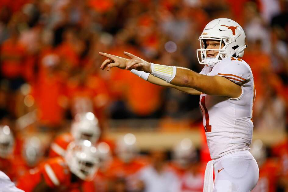 STILLWATER, OK - OCTOBER 27: Quarterback Sam Ehlinger #11 of the Texas Longhorns points out the defense of the Oklahoma State Cowboys in the second quarter on October 27, 2018 at Boone Pickens Stadium in Stillwater, Oklahoma. The Cowboys lead 31-14 at the half. (Photo by Brian Bahr/Getty Images)