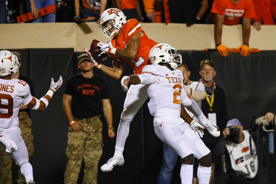 STILLWATER, OK - OCTOBER 27:  Wide receiver Tylan Wallace #2 of the Oklahoma State Cowboys pulls down a 36-yard catch to slip in for a touchdown against defensive back Kris Boyd #2 of the Texas Longhorns in the second quarter on October 27, 2018 at Boone Pickens Stadium in Stillwater, Oklahoma.  Oklahoma State leads 31-14 at the half. (Photo by Brian Bahr/Getty Images) Photo: Brian Bahr/Getty Images