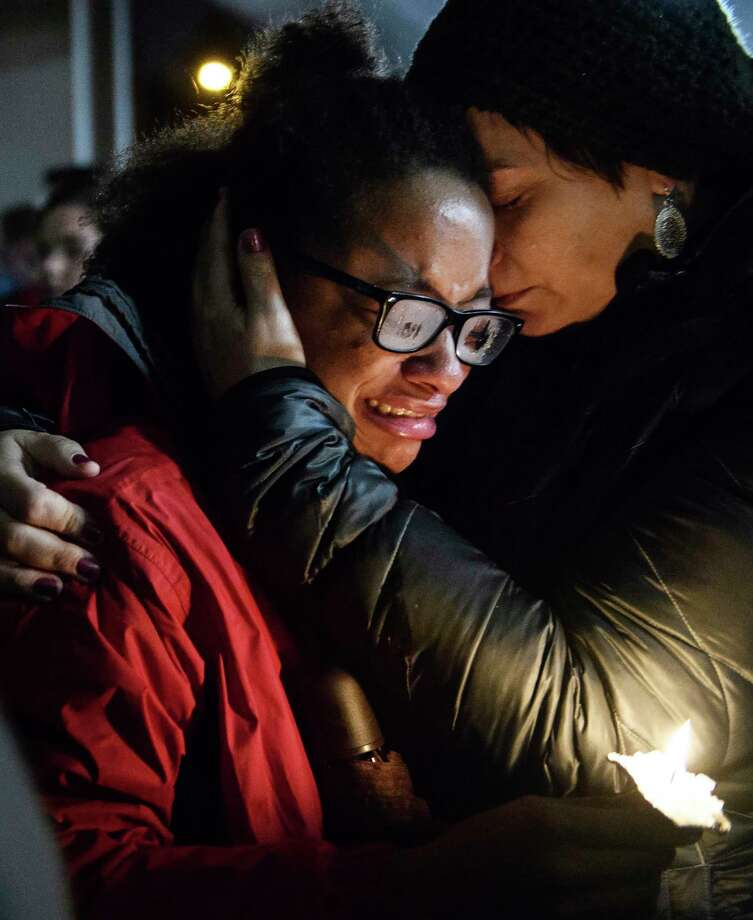 Isabel Kinnane Smith of Allderdice is comforted by Lesley Britton, a math teacher at the school, at a vigil blocks from where an active shooter shot multiple people at Tree of Life Congregation synagogue on Saturday, Oct. 27, 2018, in the Squirrel Hill section of Pittsburgh. (Stephanie Strasburg/Pittsburgh Post-Gazette via AP) Photo: Stephanie Strasburg, AP / Pittsburgh Post-Gazette