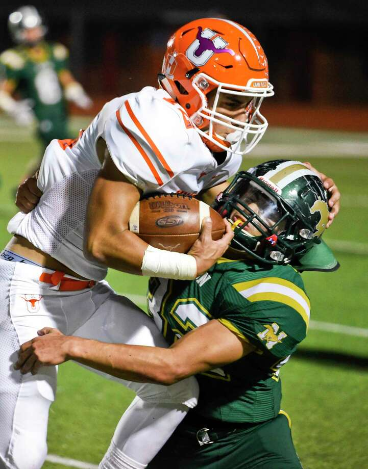 Nixon High School Andre Pedroza takes down United High School Ricky Chapa on Saturday, Oct. 27, 2018, at Shirley Field. Photo: Danny Zaragoza, Staff Photographer / Laredo Morning Times / Laredo Morning Times