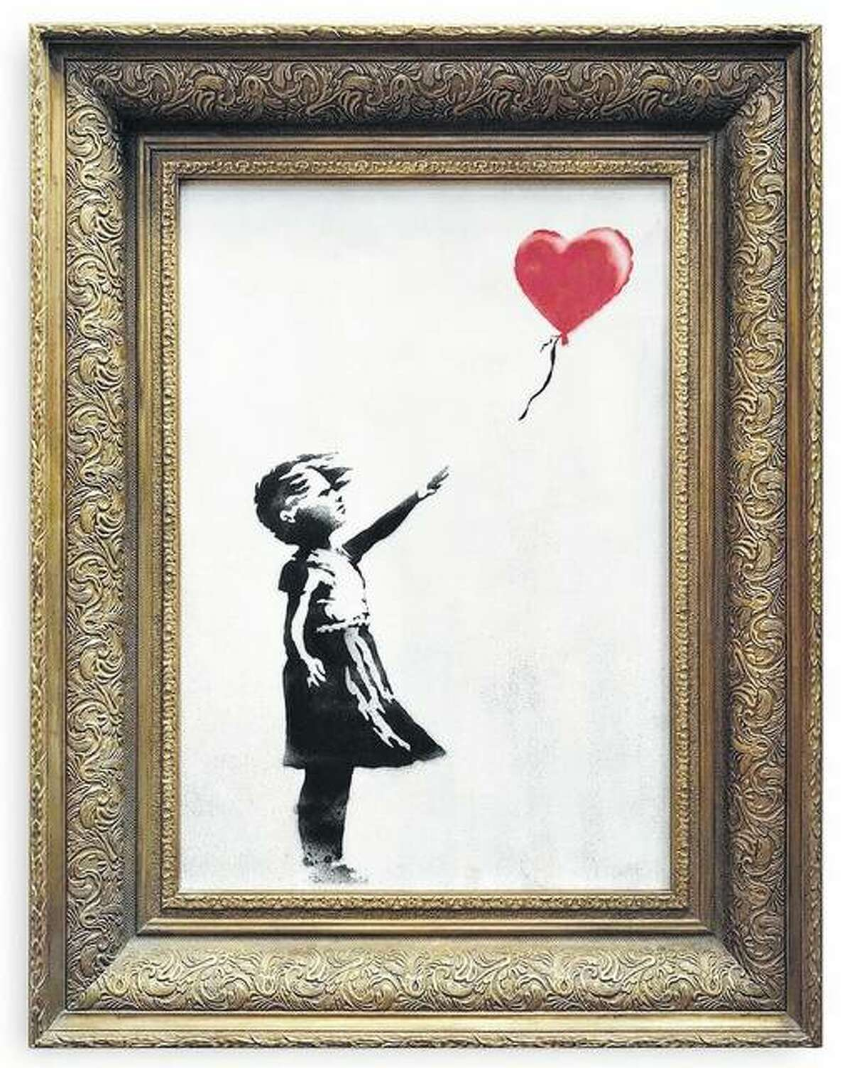 """The spray-painted canvas """"Girl with Balloon"""" by artist Banksy is the latest art to challenge the art world's concept of what art is after it was partially destroyed during its recent auction."""
