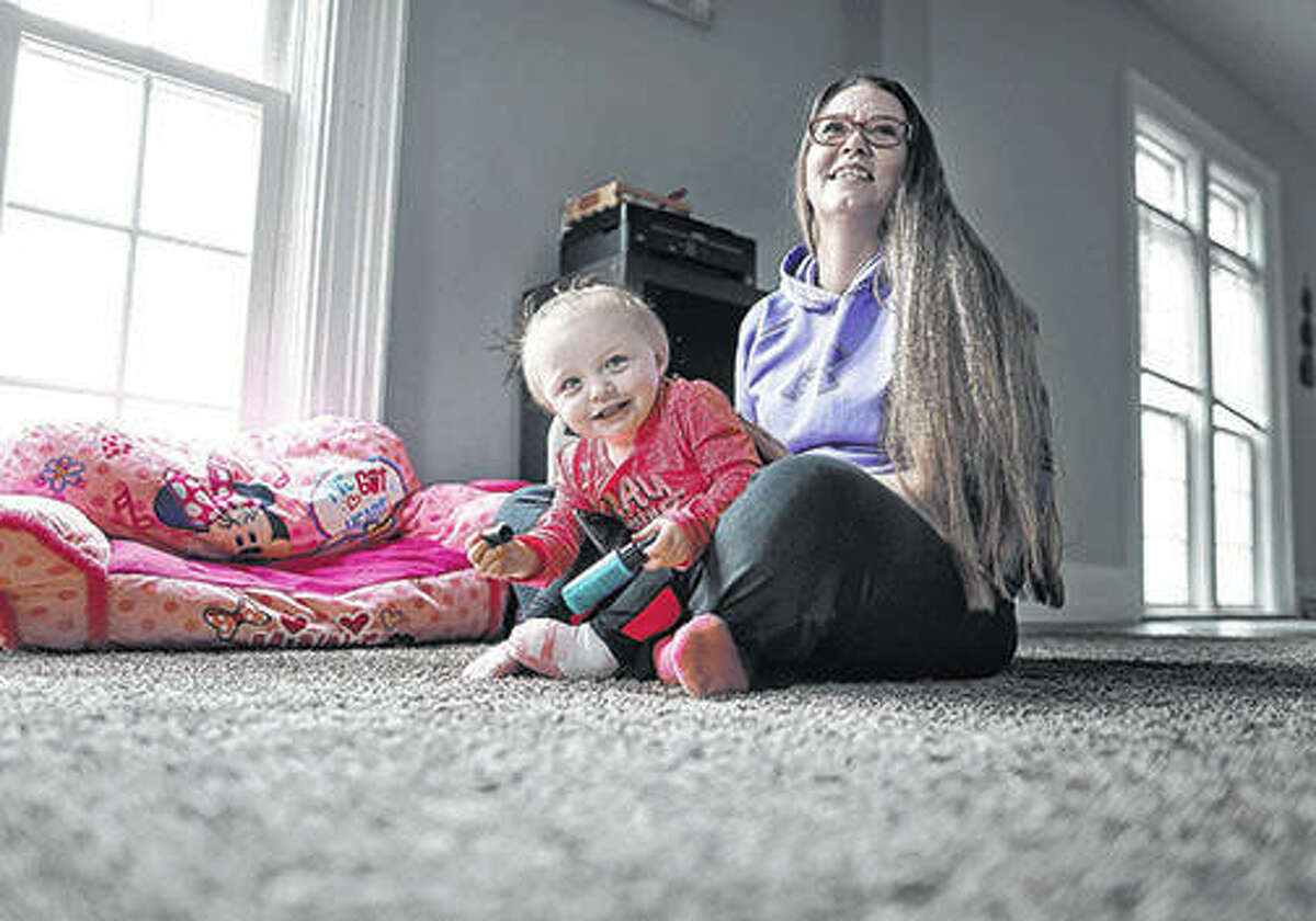 Mother and daughter smile while spending time together on an afternoon before Nicole Shipler has to leave for work. Nicole discovered she was four months pregnant while addicted to heroin. Her daughter went through withdrawal symptoms from the drug.