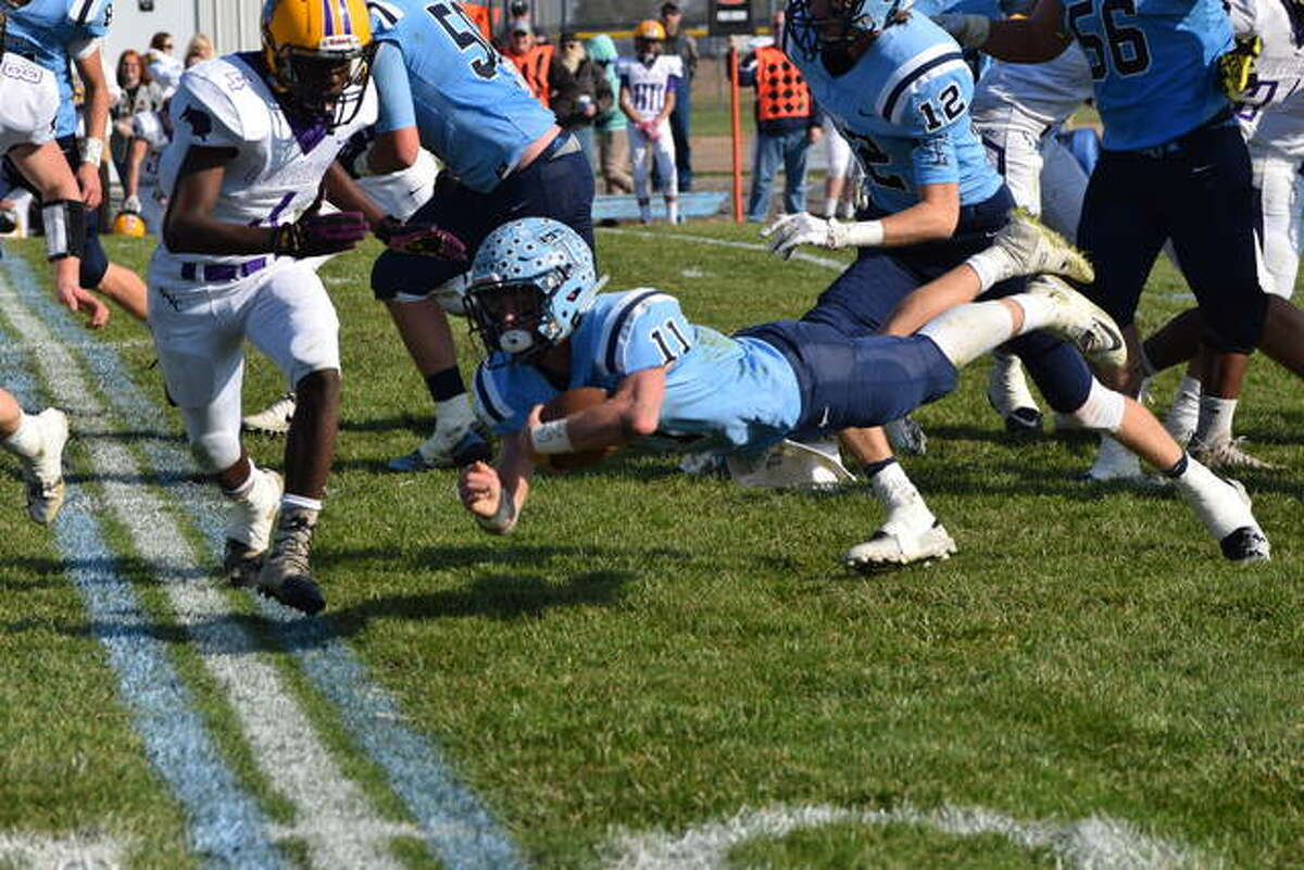 Triopia's Zach Thompson dives forward after being tripped up Saturday in an IHSA Class 1A playoff game against Georgetown-Ridge Farm.