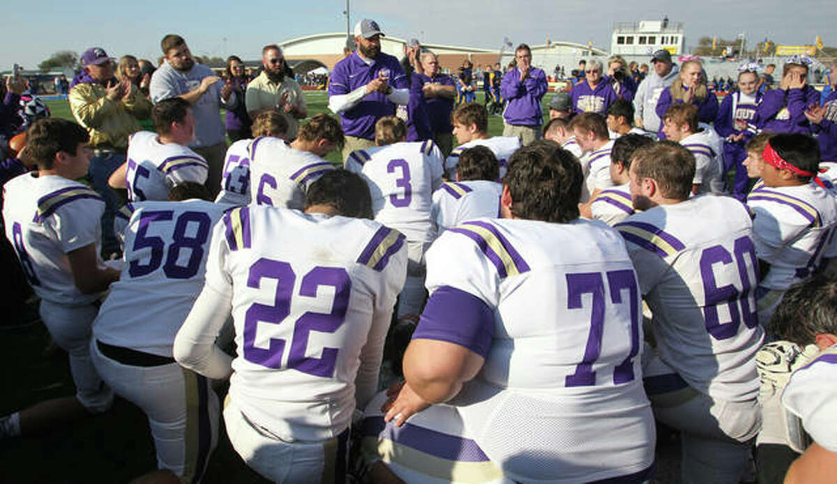 Routt coach Barry Creviston talks to his players after Saturday's game.