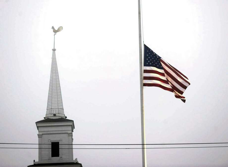 Flags across the state will fly at half-mast early this week in honor of the victims of the the mass shooting at The Tree of Life Synagogue in Pittsburgh. Photo: Carol Kaliff / Hearst Connecticut Media / The News-Times