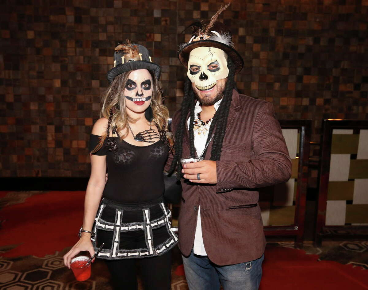Guests pose for photographs at the Saints and Sinners Halloween Soirée at Hotel Derek on Saturday, Oct. 27, 2018, in Houston.