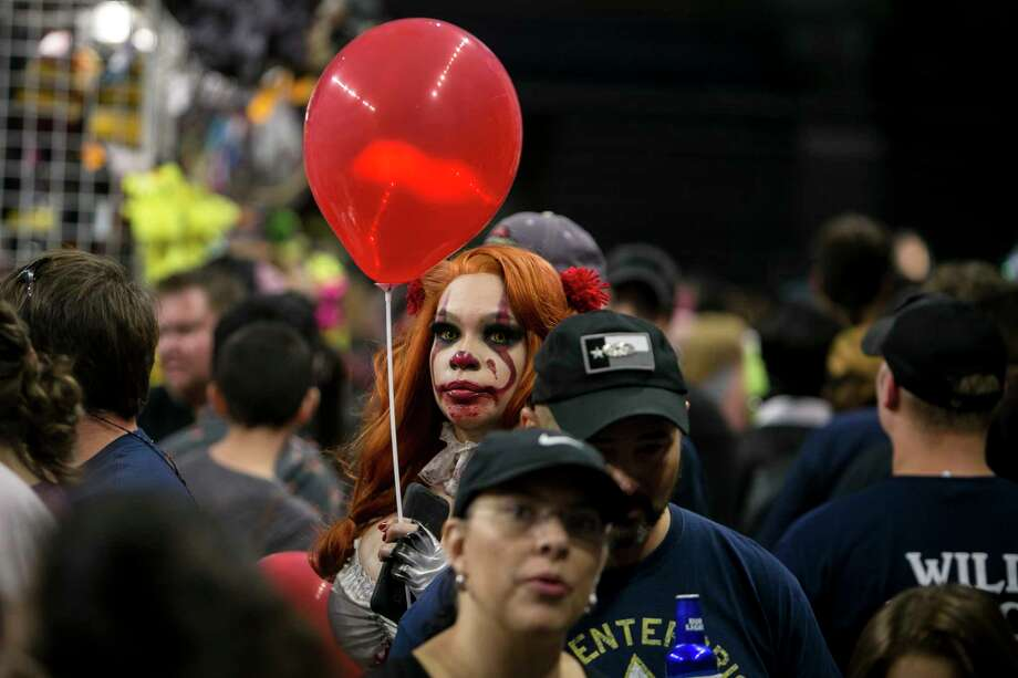 A woman cosplaying Pennywise makes her way through the crowds at Alamo City Comic Con held at the Alamodome, Saturday, Oct. 27, 2018. Photo: Josie Norris, San Antonio Express-News / © San Antonio Express-News