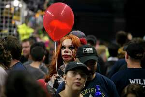 A woman cosplaying Pennywise makes her way through the crowds at Alamo Comic Con held at the Alamodome, Saturday, Oct. 27, 2018.