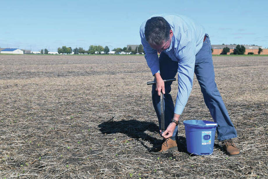Photo: University Of Illinois Extension Educator Duane Friend Takes A Soil Sample From A Field West Of Jacksonville. Farmers Send Soil Samples To A Lab To Determine Farmland Fertility. Greg Olson | Journal-Courier