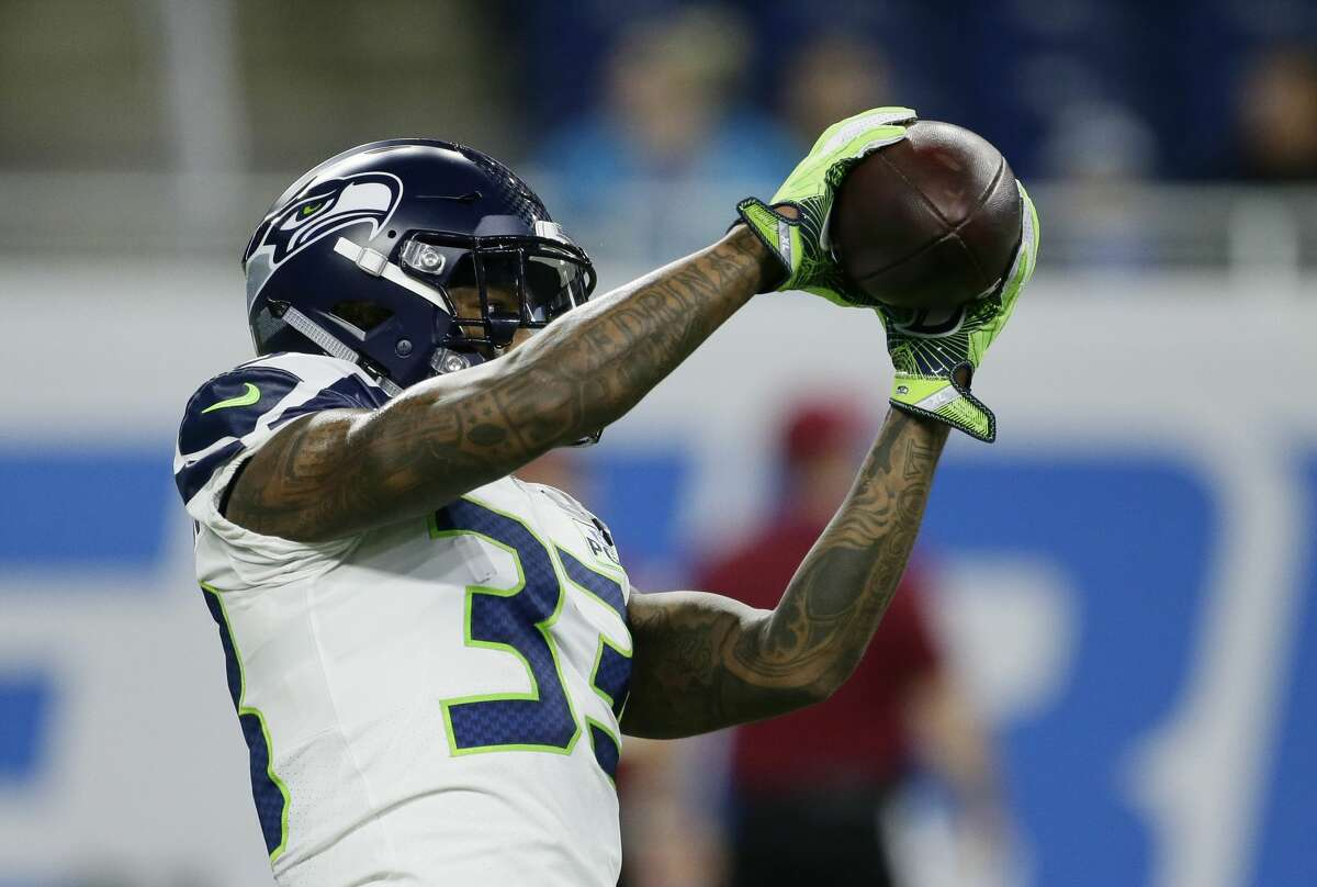 Seattle Seahawks defensive back Tedric Thompson catches during pregame of an NFL football game against the Detroit Lions, Sunday, Oct. 28, 2018, in Detroit. (AP Photo/Duane Burleson)