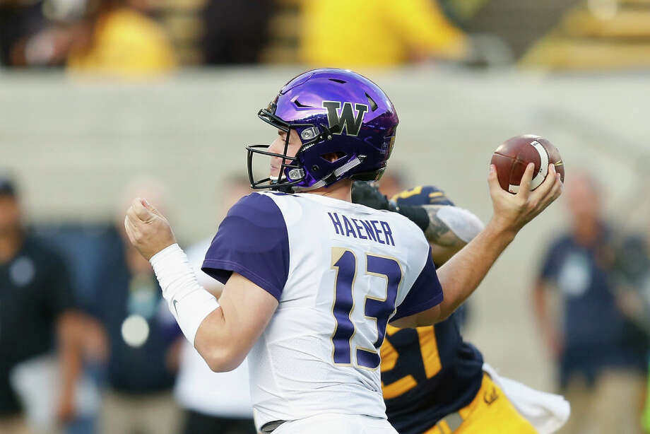 1. Who is the starting quarterback? We probably won't get a straight answer about this, but it's a more complicated situation than you might think at first glance. While Jacob Eason has been pinned by many as the likely choice, Jake Haener isn't out of the running. He reportedly had a strong offseason and worked on his physique, and has (limited) experience with Chris Petersen's playbook. Adding to the intrigue is the NFL Draft – Eason will be eligible to enter as a redshirt sophomore, and he has the arm strength to draw some serious attention. It likely won't be a major factor, but you have to wonder: if the two quarterbacks are close in performance, is Petersen more likely to roll with the guy with a couple more years to play, or the one who will likely leave after a good year?  Photo: Lachlan Cunningham/Getty Images / 2018 Getty Images