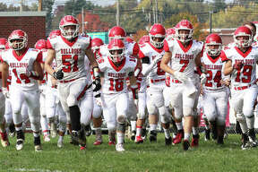 The Staunton Bulldogs take the field before their Class 2A football first-round playoff game against the Decatur St. Teresa Bulldogs on Saturday in Decatur. St. Teresa improved to 10-0 with a 45-0 victory that ended Staunton' season at 5-5.