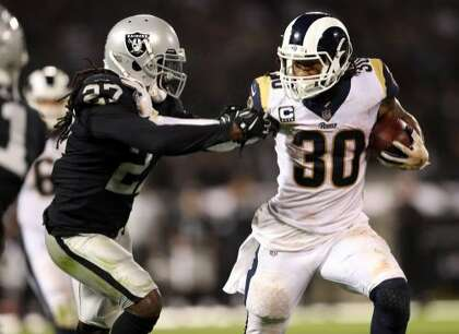 69874546f Oakland Raiders' Reggie Nelson tries to stop Los Angeles Rams' Todd Gurley  II in 4th quarter during Rams' 33-13 win in NFL game at Oakland Coliseum in  ...