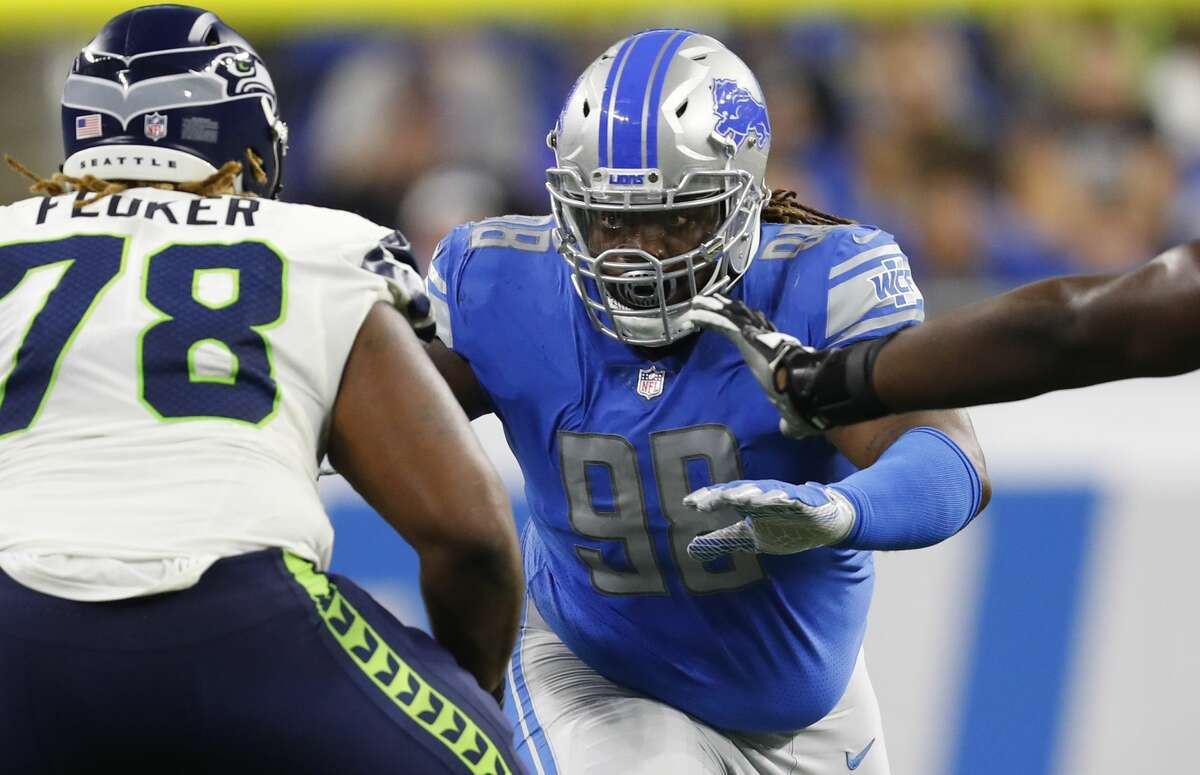 Detroit Lions defensive tackle Damon Harrison Sr. (98) goes up against Seattle Seahawks offensive guard D.J. Fluker (78) during the first half of an NFL football game, Sunday, Oct. 28, 2018, in Detroit. (AP Photo/Paul Sancya)