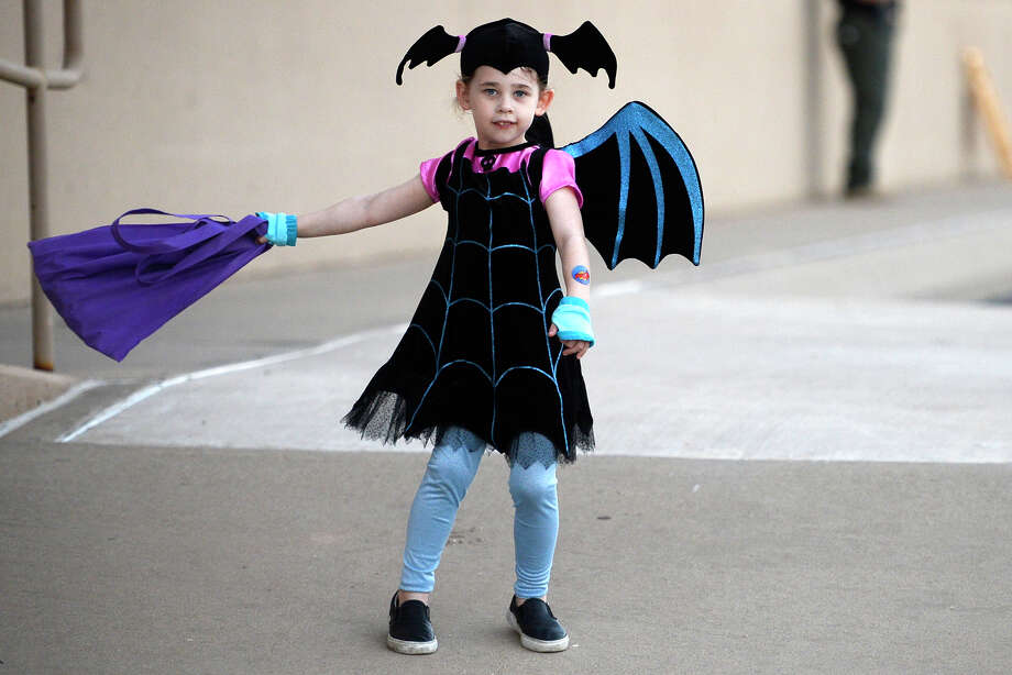 Emerson Green, age 5, dressed as Vampirina, enjoys the Fall Festival Oct. 28, 2018, at Midland County Public Library Centennial Branch. James Durbin/Reporter-Telegram Photo: James Durbin / ? 2018 Midland Reporter-Telegram. All Rights Reserved.