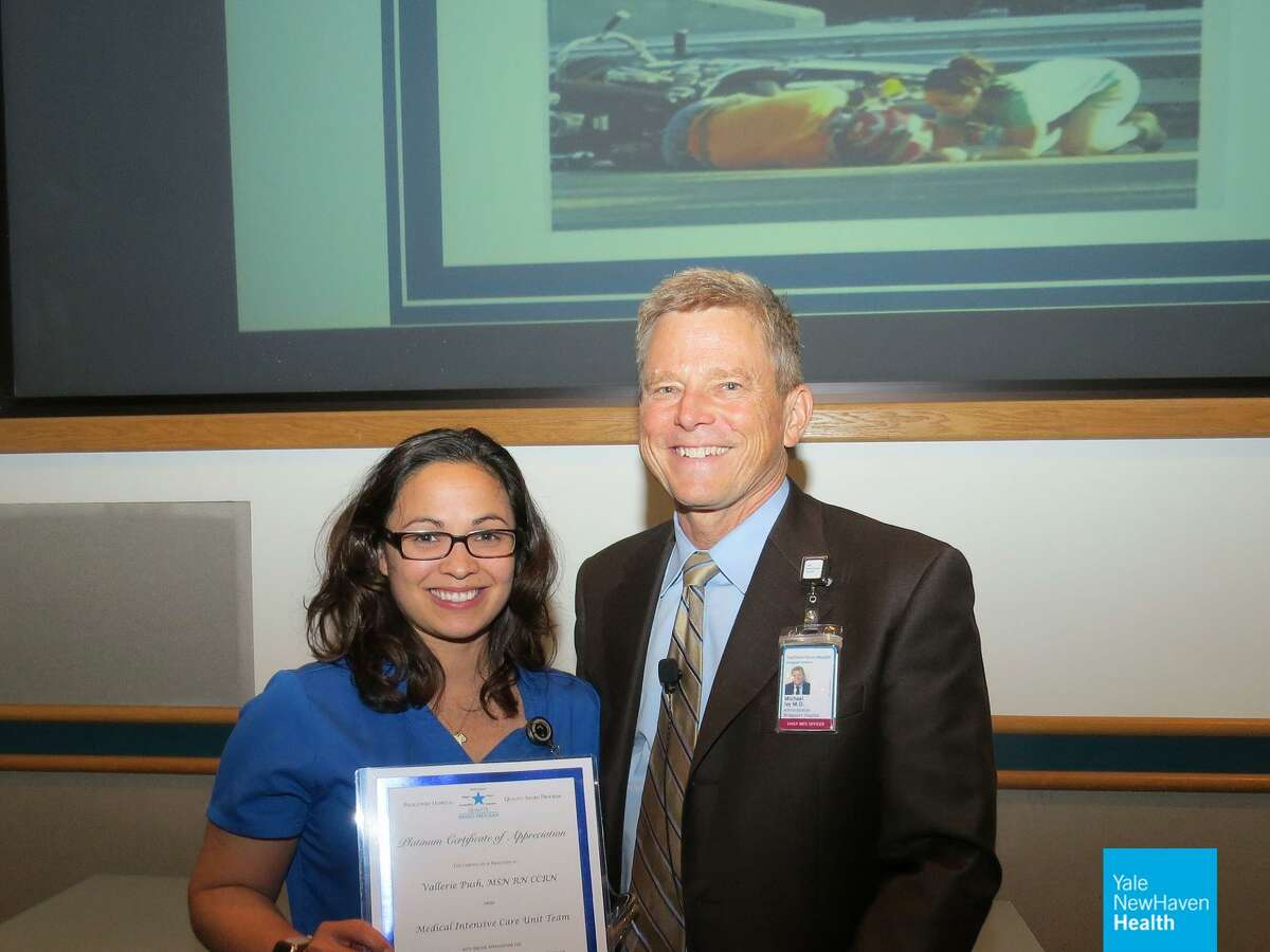 Medical intensive care unit nurse Vallerie Push with Bridgeport Hospital interim president and CEO Michael Ivy. Push received a Quality Award following a roadside rescue of a man who crashed his motorcycle.