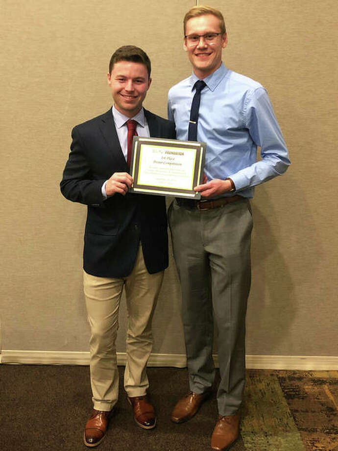 SIUE student researchers Brentsen Wolf, left, and Gregory Takacs earned first place for scientific merit at the Illinois Pharmacists Association September meeting. Photo: For The Telegraph