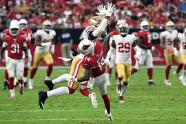 GLENDALE, AZ - OCTOBER 28:  Linebacker Reuben Foster #56 of the San Francisco 49ers breaks up a pass intended for wide receiver J.J. Nelson #14 of the Arizona Cardinals during the second quarter at State Farm Stadium on October 28, 2018 in Glendale, Arizona.  (Photo by Norm Hall/Getty Images)