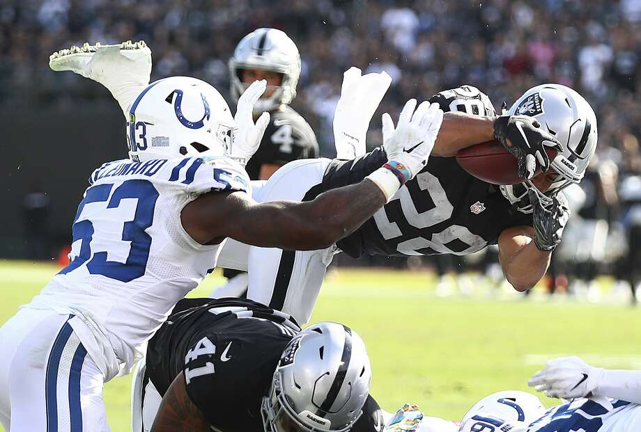 Oakland Raiders running back Doug Martin (28) dives in front of Indianapolis Colts linebacker Darius Leonard (53) during the second half of an NFL football game in Oakland, Calif., Sunday, Oct. 28, 2018. (AP Photo/Ben Margot) Photo: Ben Margot / Associated Press