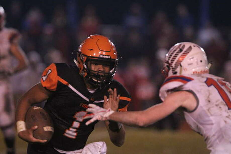 DJ McWilliams heads up field at an IHSA Class 3A playoff game against Pleasant Plains Saturday. Photo: Dennis Mathes | Journal-Couier