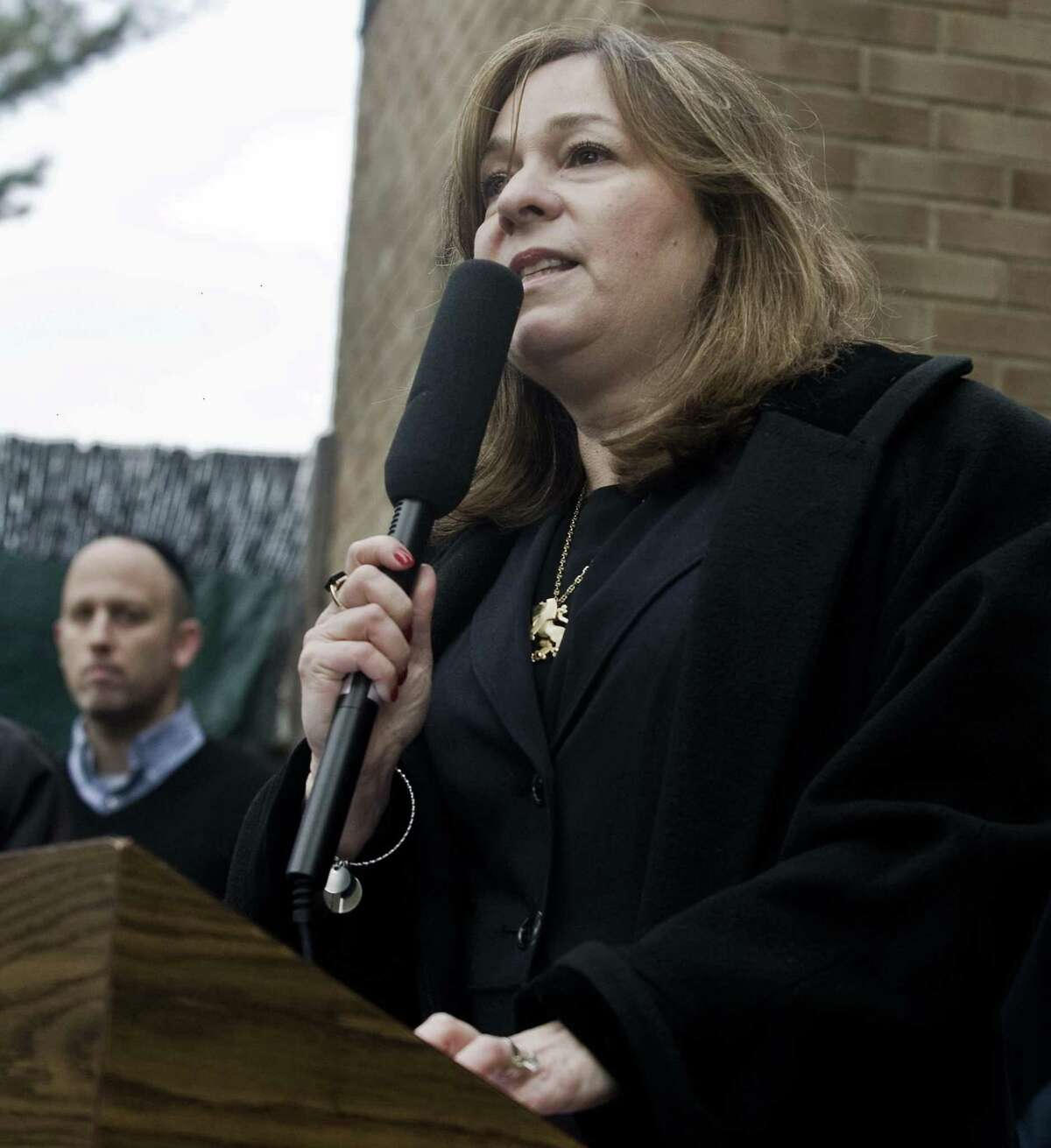Pam Ehrenkranz, CEO of UJA-JCC of Greenwich, speaks to the gathering during a vigil at Agudath Sholom in Stamford, for the loss of life at the Tree of Life synagogue in Pittsburgh. Sunday, Oct. 28, 2018