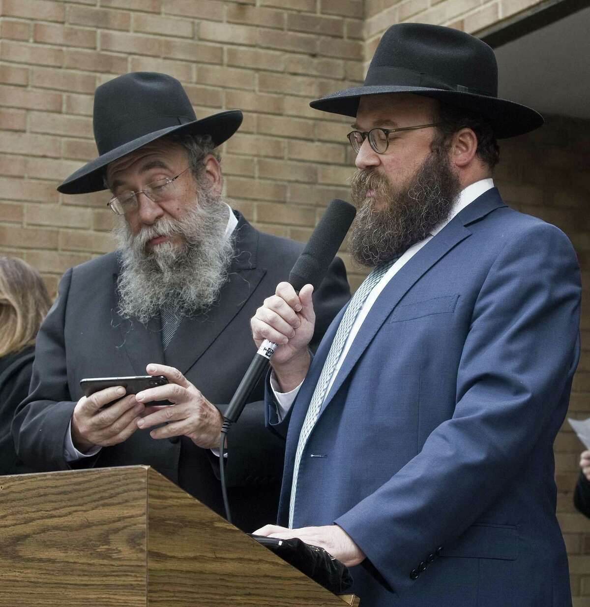 Rabbi Yisrael Deren, of Chabad of Stamford, and Rabbi Yossi Deren, of Chabad of Greenwich, address the vigil at Agudath Sholom in Stamford, for the loss of life at the Tree of Life synagogue in Pittsburgh. Sunday, Oct. 28, 2018