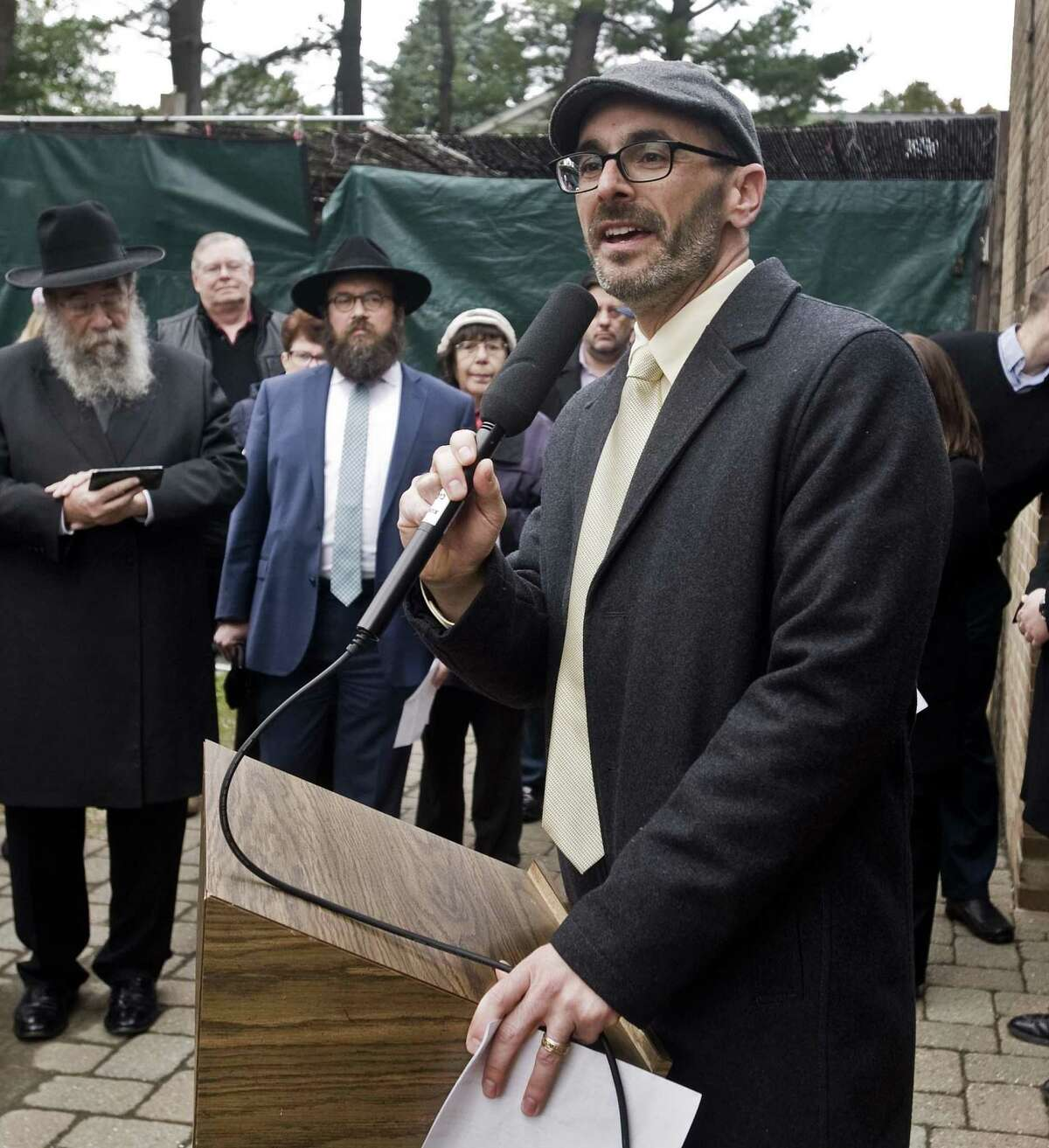 Rabbi Jay Tel Rav of Temple Sinai in Stramford, speaks to the gathering during a vigil at Agudath Sholom in Stamford, for the loss of life at the Tree of Life synagogue in Pittsburgh. Sunday, Oct. 28, 2018