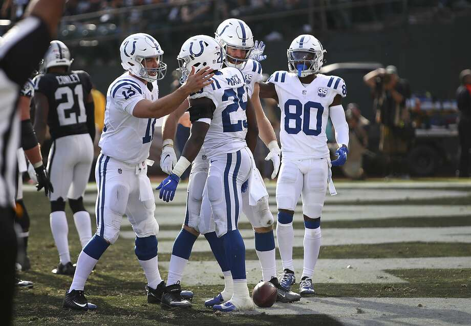 Indianapolis Colts running back Marlon Mack (25) celebrates with quarterback Andrew Luck (12) and teammates after scoring against the Oakland Raiders during the second half of an NFL football game in Oakland, Calif., Sunday, Oct. 28, 2018. (AP Photo/Ben Margot) Photo: Ben Margot, Associated Press