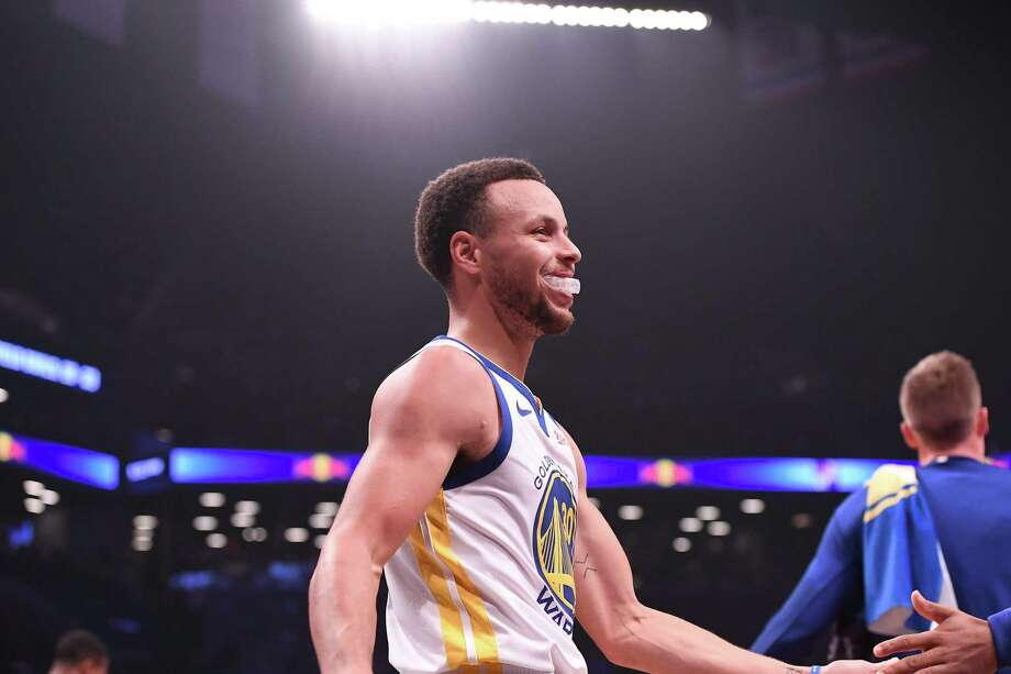 86787a28fd5 Stephen Curry and Kevin Durant power Warriors to win over Nets - SFGate
