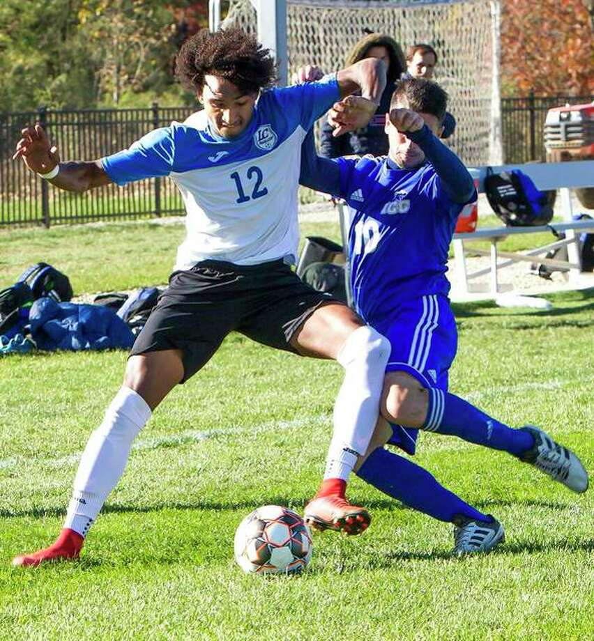 Reshaun Walkes of Lewis and Clark (12) battles for the ball with Illinois central College's Federico Zanna during action in Sunday's Region 24 men's tournament championship game at LCCC. Illinois Central won 3-1. Photo: Jan Dona, LCCC | For The Telegraph