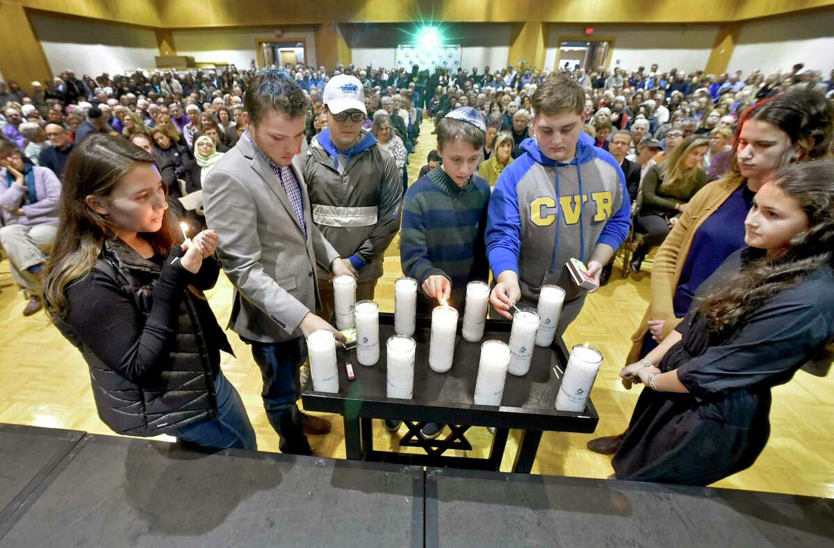 Woodbridge, Connecticut - Sunday, October 28, 2018: Representatives from the International Jewish Teen Youth Group, the BBYO regional chapter from the Connecticut Valley, light candles in memory of those lost in the Pittsburg Synaogue shooting during a vigil at the Jewish Community Center in Woodbridge Sunday evening sponsored by the Jewish Federation of Greater New Haven and held held in response to the Pittsburgh shooting Saturday.
