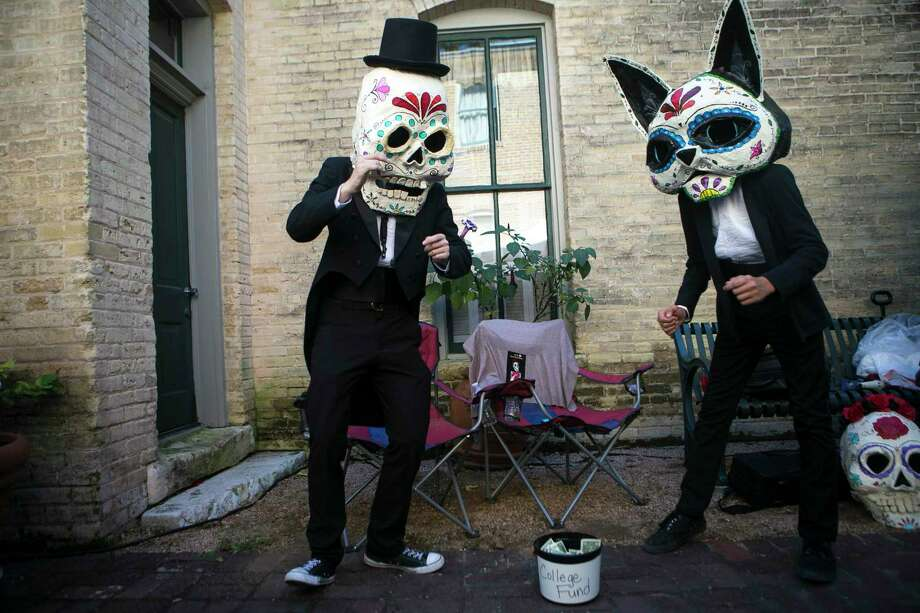 Masked individuals dance during Muertos Fest in La Villita last year. A reader wonders if we have lost sight of the meaning of All Souls Day. Photo: Josie Norris /Staff File Photo / © San Antonio Express-News
