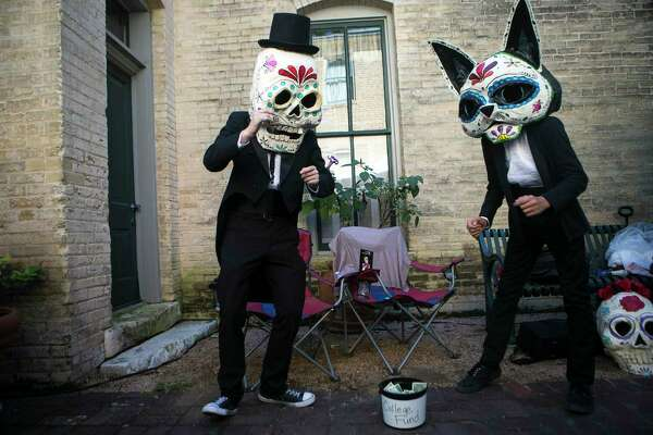 Masked individuals dance during Muertos Fest in La Villita last year. A reader wonders if we have lost sight of the meaning of All Souls Day.