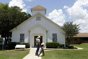 Rod Green walks with his granddaughter as they visit the First Baptist Church in Sutherland Springs. The building is now a memorial. Nearly one year after the Sutherland Springs church massacre, the Sutherland Springs community mourns over another shooting at a house of worship, this time a Pittsburgh synagogue.