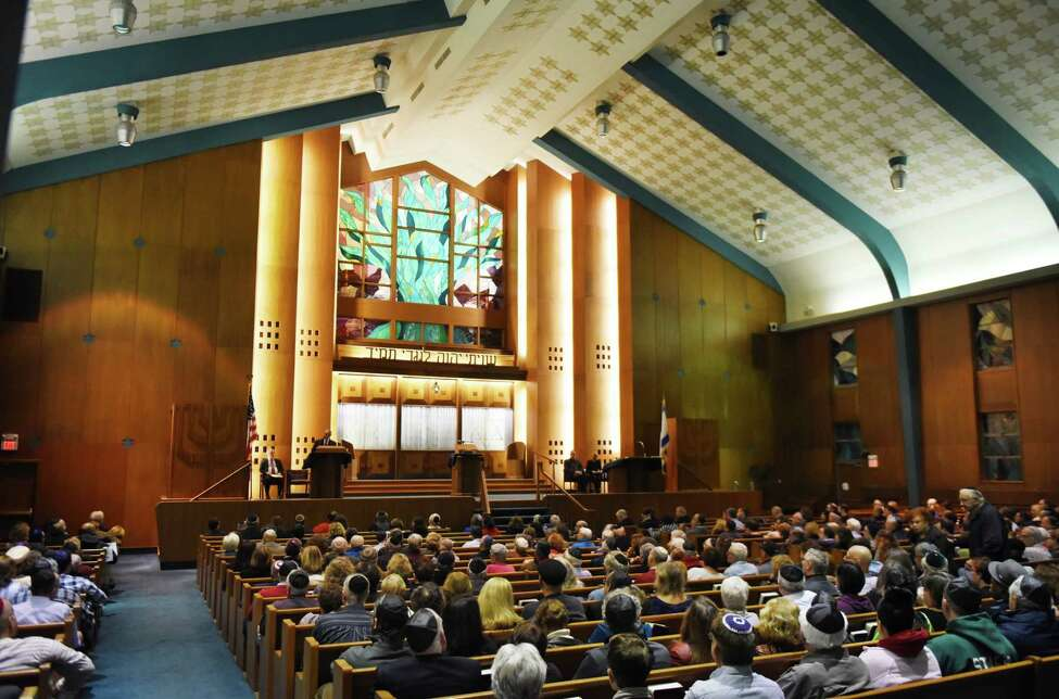 Worshipers gathered take part in a community prayer service for the victims of the Pittsburgh synagogue shooting on Sunday, Oct. 28, 2018, at Temple Israel in Albany, N.Y. (Will Waldron/Times Union)