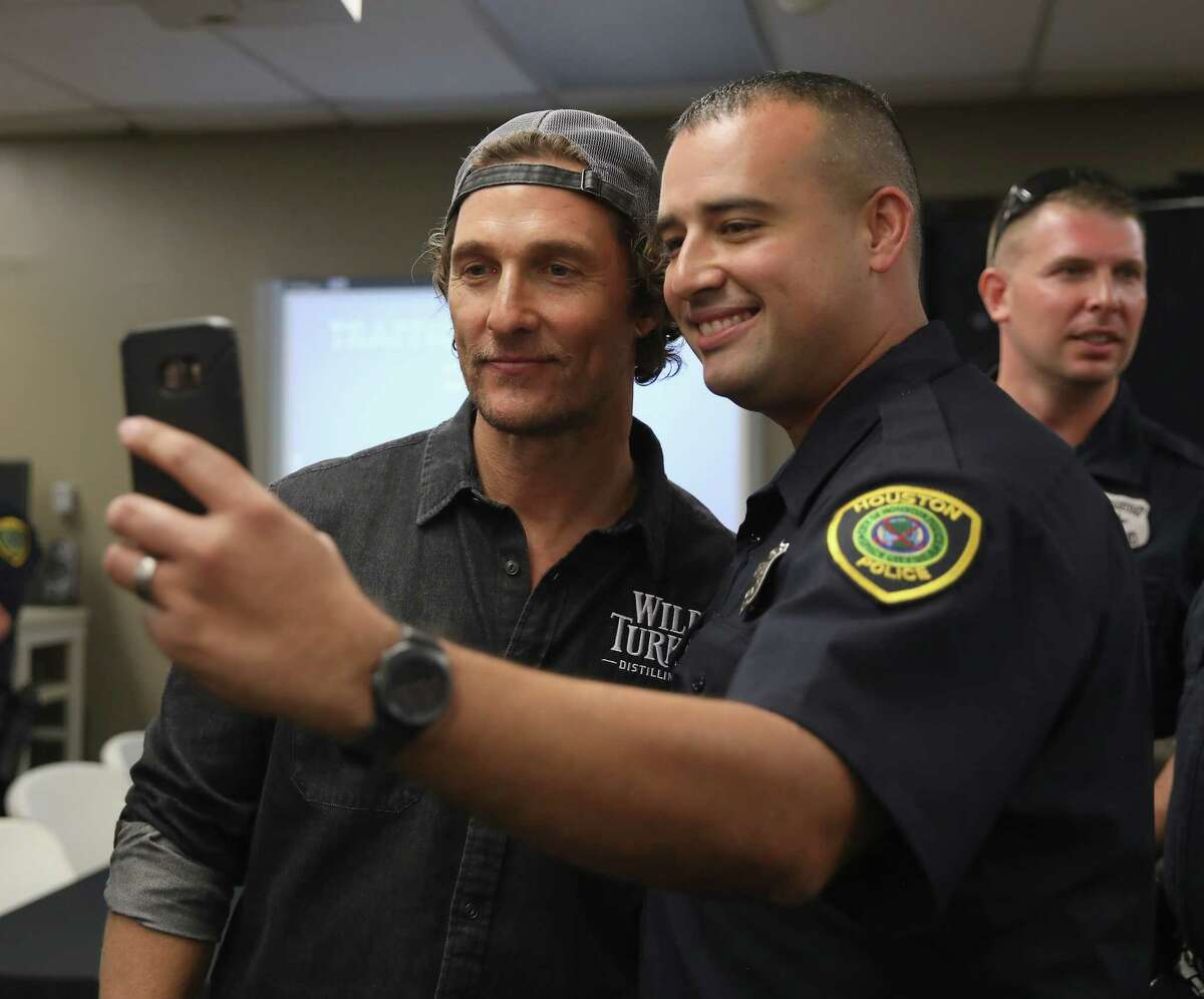 Matthew McConaughey takes photos with Houston's Police Department officer during Wild Turkey gives back 2018.